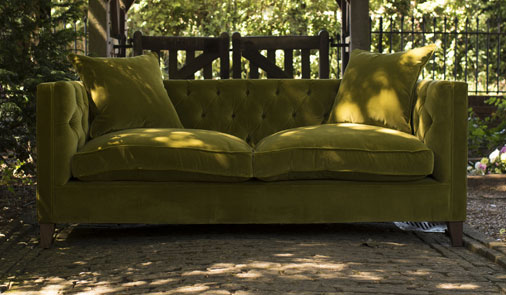 Haresfield large sofa in green velvet in a garden