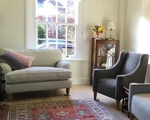Customer Image: Alwinton Snuggler in Tough As Houses Silver & Sennen Chair in Colefax & Fowler Milne Old Blue