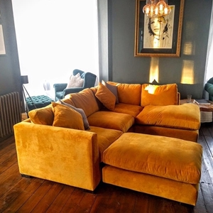 Shop Our Edit: Wadenhoe Corner Unit & FootstoolOrange velvet corner sofa in Warwick Plush Velvet Turmeric