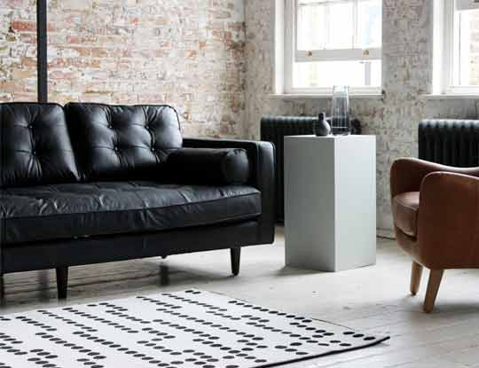 3 seater black leather sofa in room set inspiration page