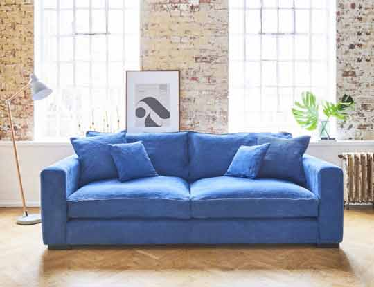 Blue fabric sofa in home inspiration page