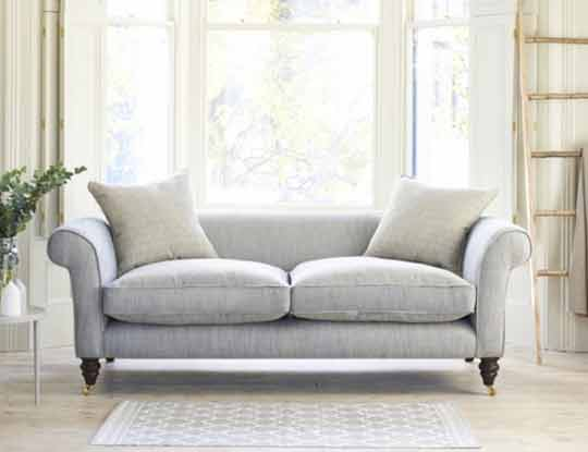 2 seater neutral sofa in living room setting