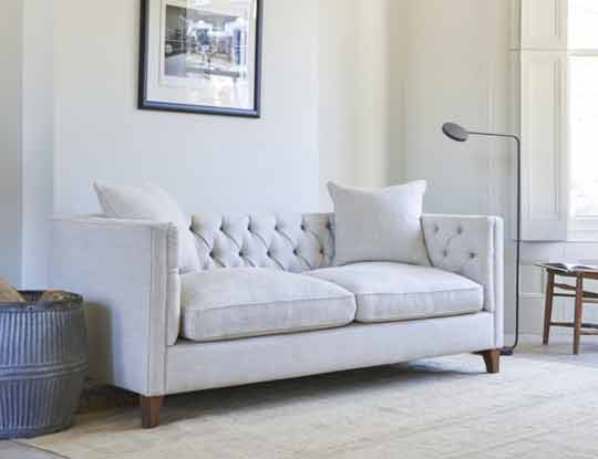 white chesterfield sofa style in living room