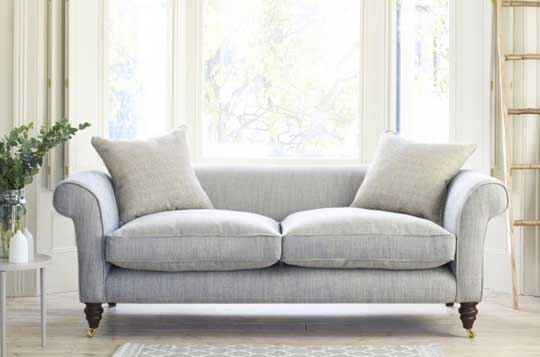 grey fabric chesterfield sofa on wooden floor inspiration page
