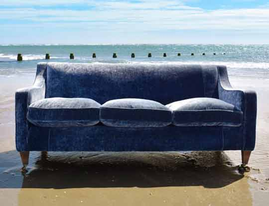 blue crushed velvet sofa on the beach inspiration page