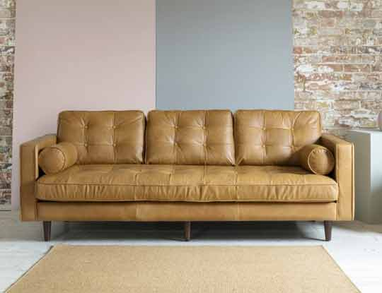 brown leather sofa in room set inspire page