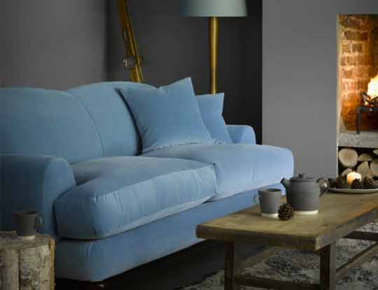 large plain sofa in blue velvet fabric